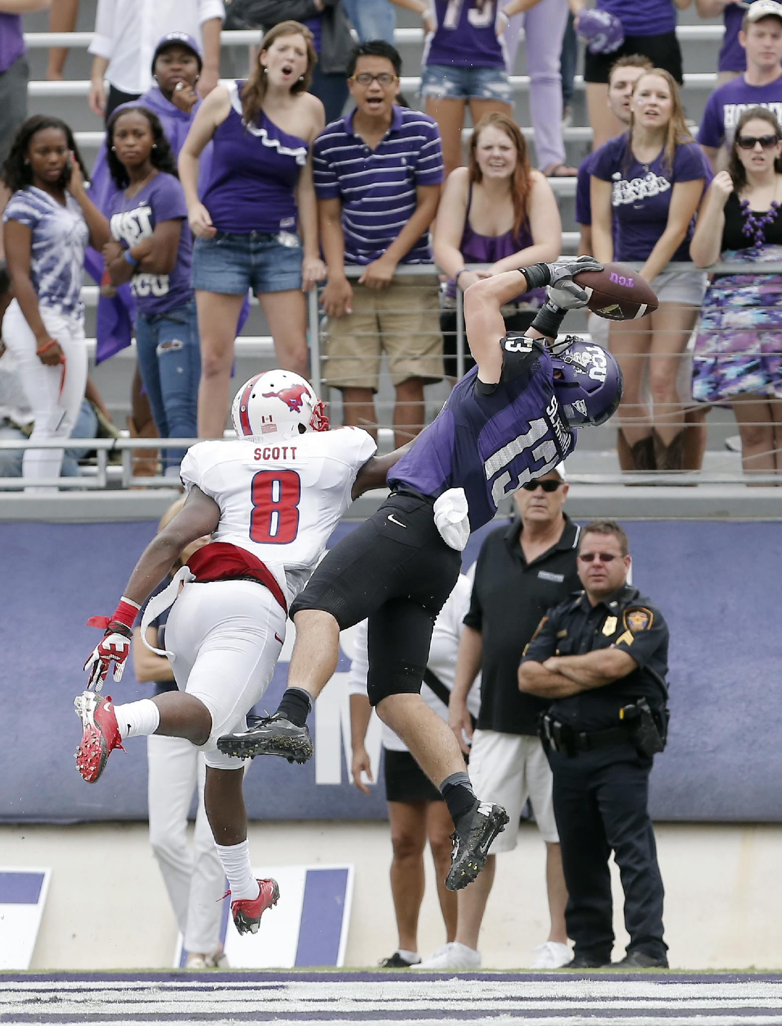 TCU wide receiver Ty Slanina (13) catches a pass for a touchdown as SMU defensive back Jay Scott (8) defends during the second half of an NCAA college football game Saturday, Sept. 28, 2013, in Fort Worth, Texas. TCU won 48-17