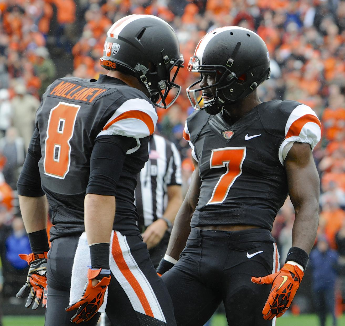 Oregon State's Brandin Cooks (7) celebrates his catch against Colorado with Richard Mullaney (8) in the first half of an NCAA college football game in Corvallis, Ore., Saturday, Sept 28, 2013