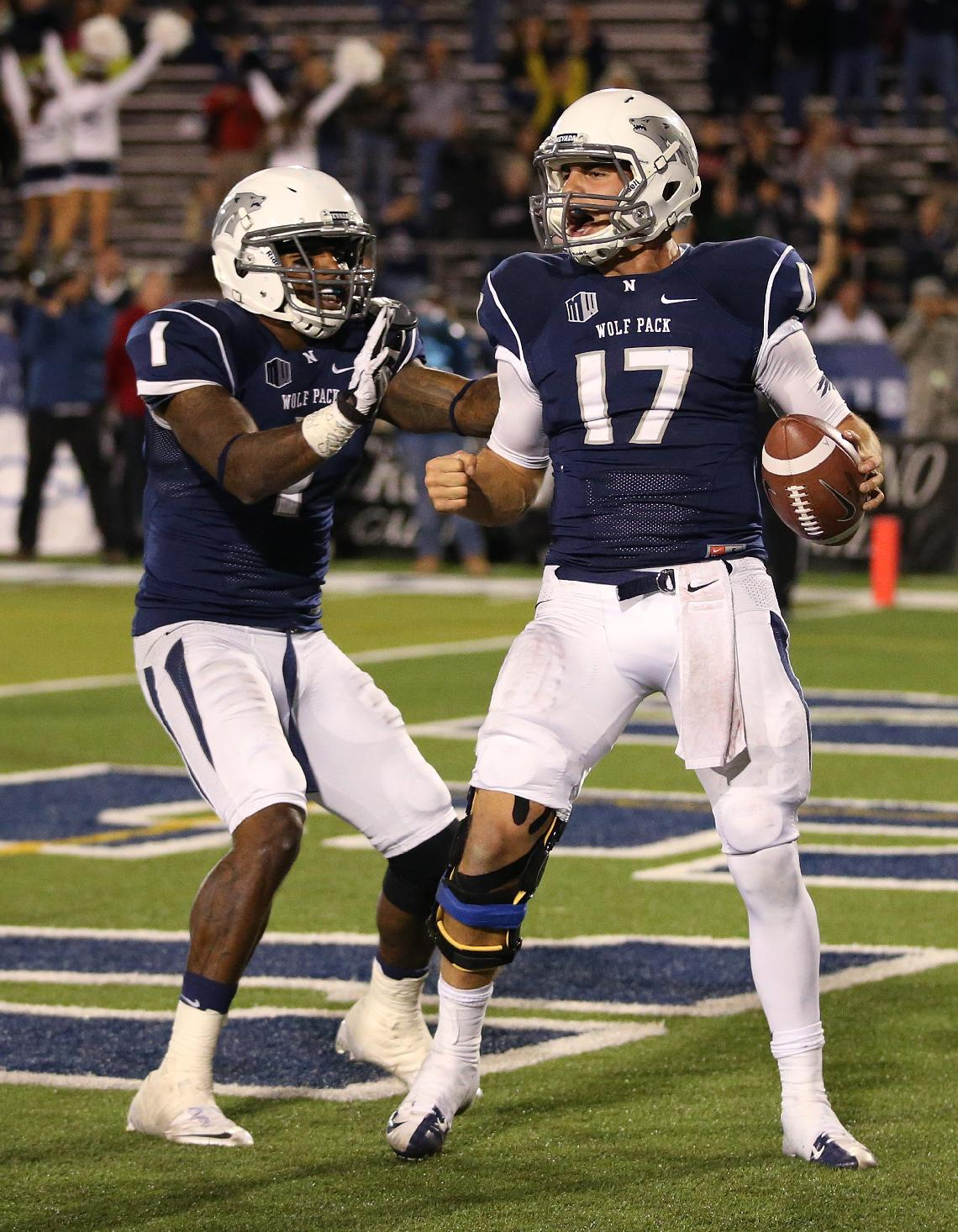 Nevada's Cody Fajardo (17) celebrates with Brandon Wimberly (1) after scoring the game-winning touchdown against Air Force during the second half of an NCAA football game in Reno, Nev., on Saturday, Sept. 28, 2013. Nevada won 45-42