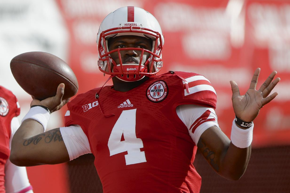 Nebraska quarterback Tommy Armstrong Jr. (4) throws during warmups before an NCAA college football game against Illinois in Lincoln, Neb., Saturday, Oct. 5, 2013