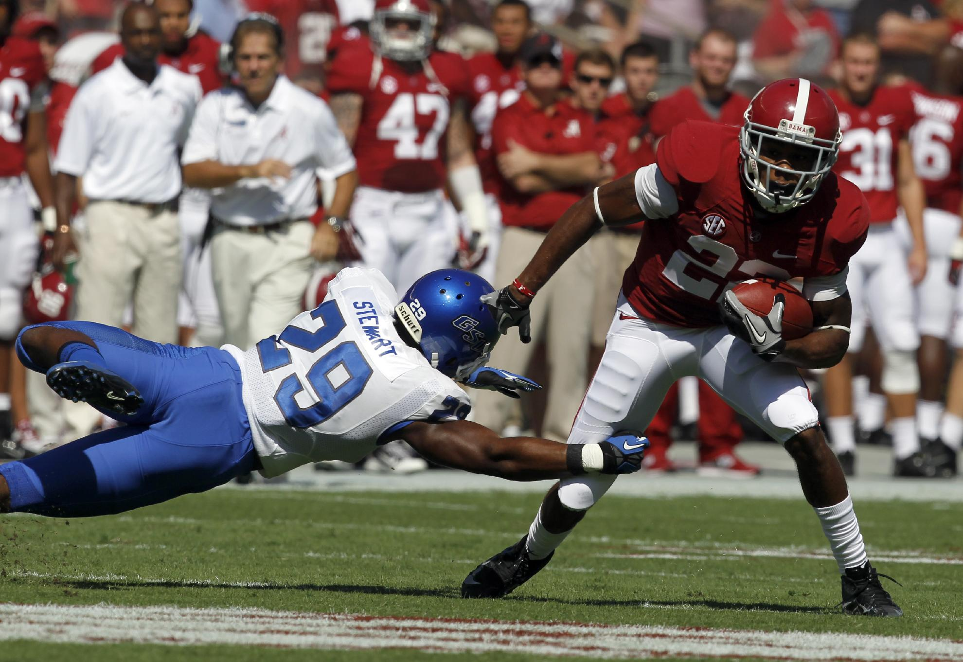 Alabama wide receiver Christion Jones (22) catches a pass and eludes the tackle of Georgia State safety Rashad Stewart (29) for a first down during the first half of an NCAA college football game on Saturday, Oct. 5, 2013, in Tuscaloosa, Ala