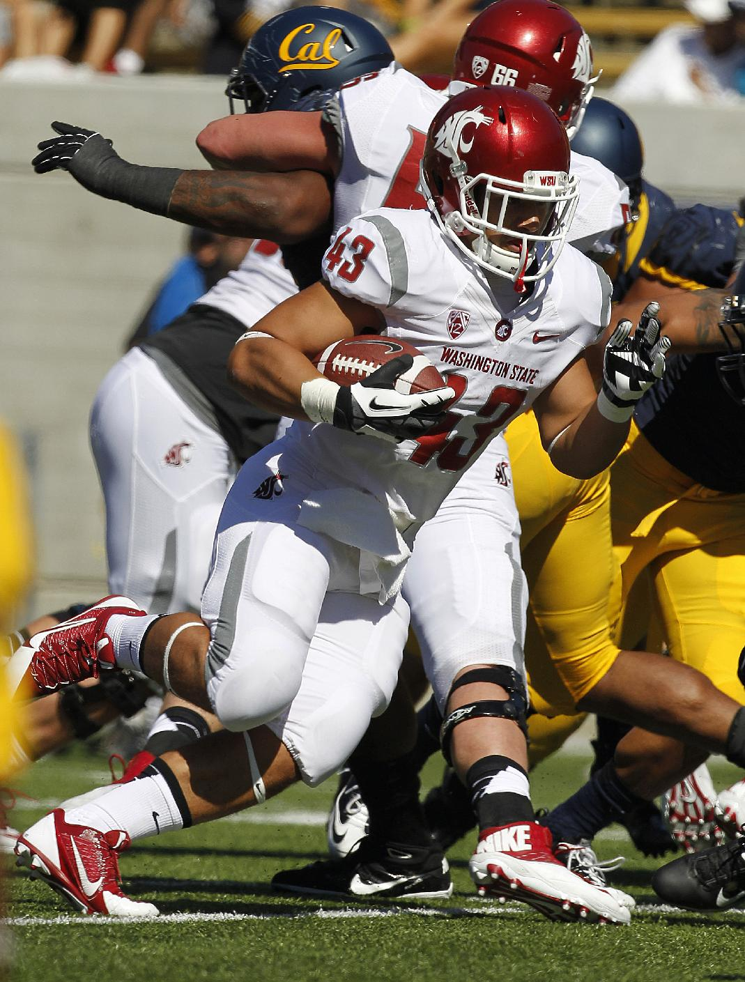 Washington State running back Jeremiah Laufasa (43) runs for a touchdown against California during the first half of an NCAA college football game in Berkeley, Calif., Saturday, Oct. 5, 2013