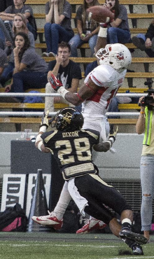 Fresno State wide receiver Davante Adams (15) makes a touchdown catch over Idaho's Solomon Dixon (28) during the first half of an NCAA college football game Saturday, Oct. 5, 2013, in Moscow, Idaho