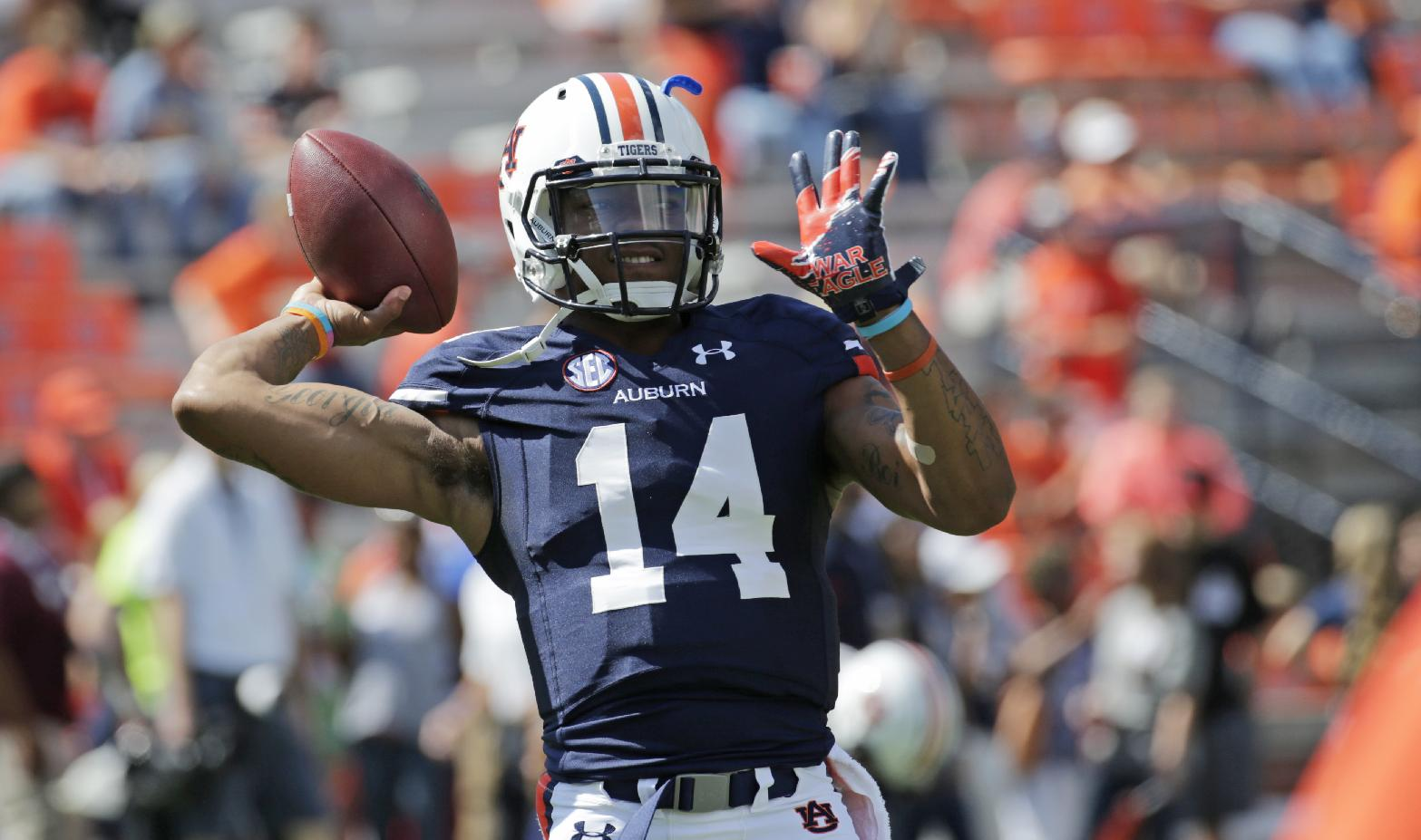 Auburn quarterback Nick Marshall (14) warms up prior to the start of an NCAA college football game against Western Carolina in Auburn, Ala., Saturday, Oct. 12, 2013