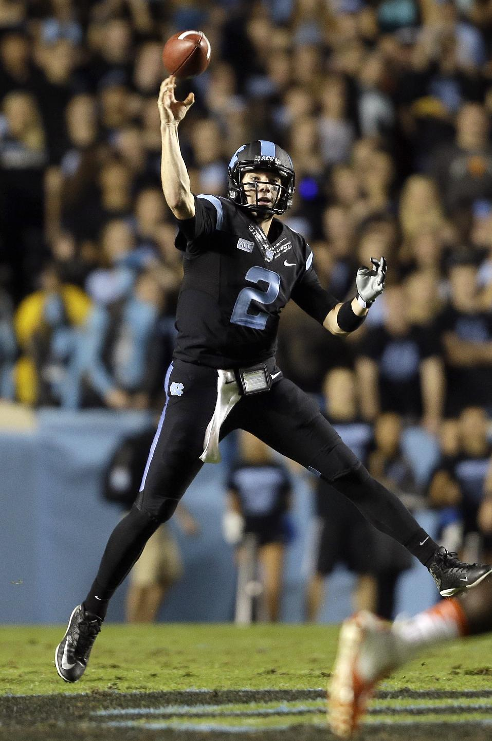 North Carolina quarterback Bryn Renner (2) passes against Miami during the first half of an NCAA college football game in Chapel Hill, N.C., Thursday, Oct. 17, 2013
