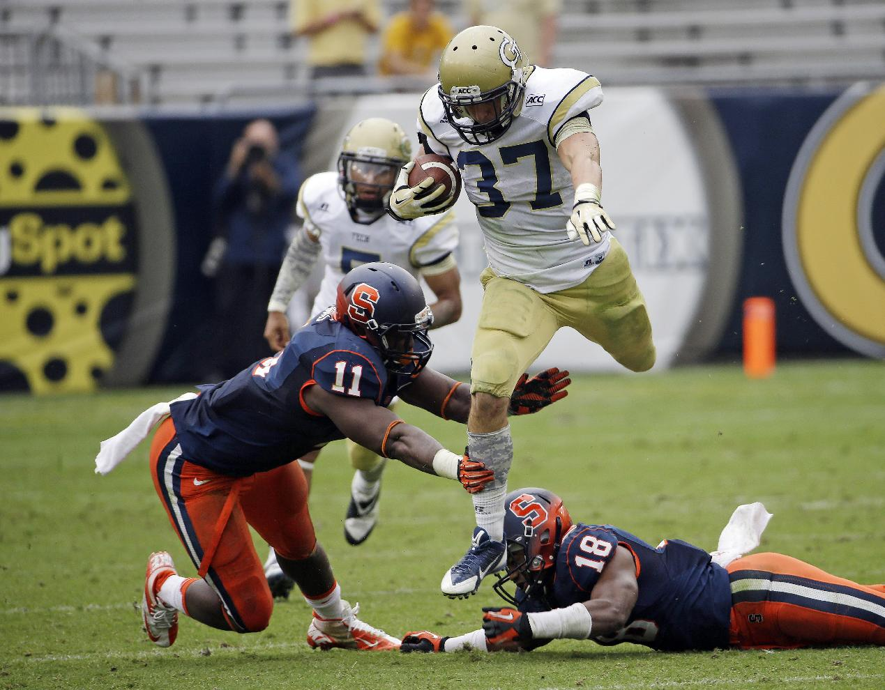 Georgia Tech running back Zach Laskey (37) gets away from Syracuse linebacker Marquis Spruill (11) and defensive back Darius Kelly (18) in the second half of an NCAA college football game Saturday, Oct. 19, 2013, in Atlanta. Tech won 56-0