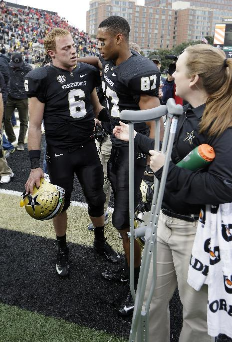Vanderbilt quarterback Austyn Carta-Samuels (6) talks with wide receiver Jordan Matthews (87) as they leave the field after upsetting No. 15 Georgia 31-27 in an NCAA college football game on Saturday, Oct. 19, 2013, in Nashville, Tenn. Cara-Samuels injured his leg in the second quarter and watched the remainder of the game from the sideline