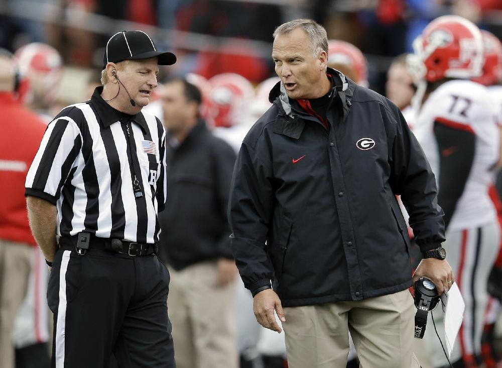 Georgia head coach Mark Richt argues with head linesman Gary Jayroe, left, in the fourth quarter of an NCAA college football game against Vanderbilt on Saturday, Oct. 19, 2013, in Nashville, Tenn. Vanderbilt upset No. 15 Georgia 31-27