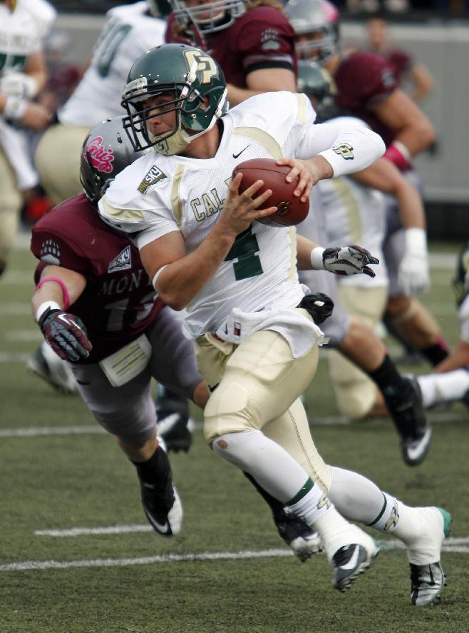 Cal Poly quarterback Dano Graves(4) scrambles in the first quarter against Montana in an NCAA college football game in Missoula, Mont., Saturday, Oct. 19, 2013