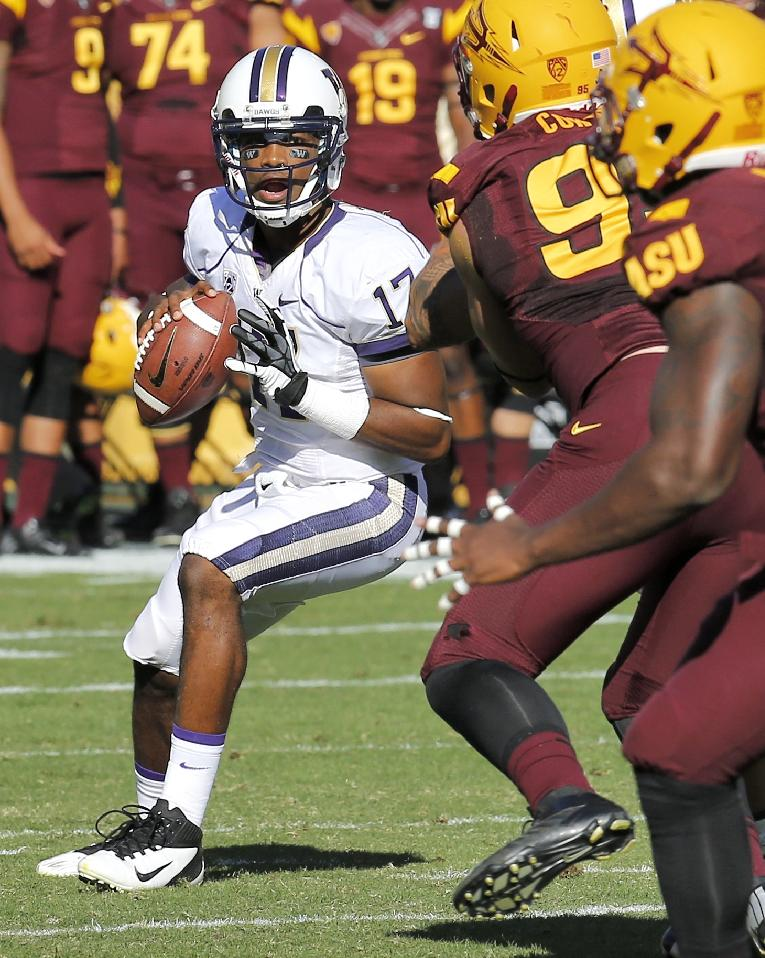 Washington quarterback Keith Price (17) looks to pass against Arizona State during the first half of an NCAA college football game, Saturday, Oct. 19, 2013, in Tempe, Ariz