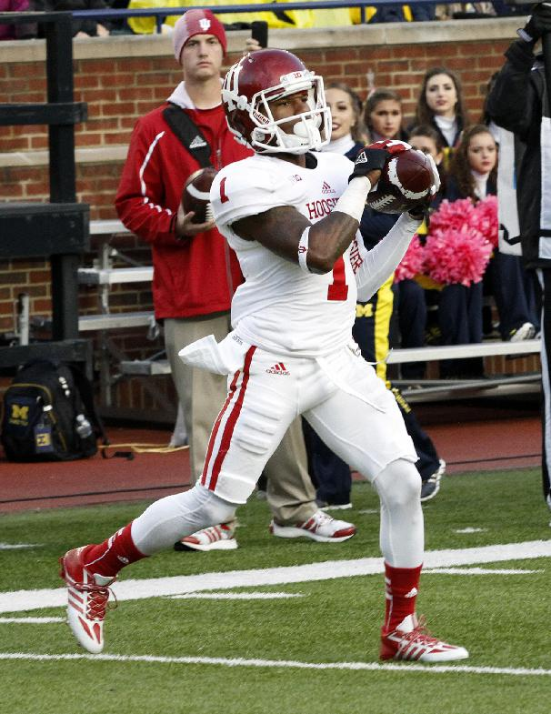 Indiana wide receiver Shane Wynn steps into the end zone for a third quarter touchdown catch against Michigan in an NCAA football game at Michigan Stadium in Ann Arbor, Saturday, Oct. 19, 2013