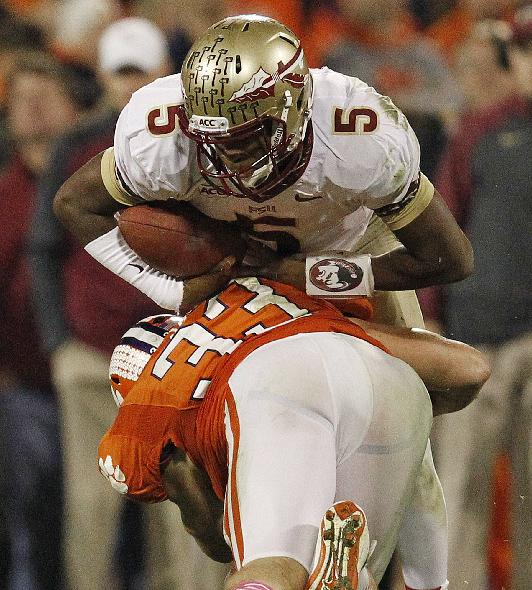 Clemson linebacker Spencer Shuey (33) hits Florida State quarterback Jameis Winston (5) during the second half of an NCAA college football game, Saturday, Oct. 19, 2013, in Clemson, S.C