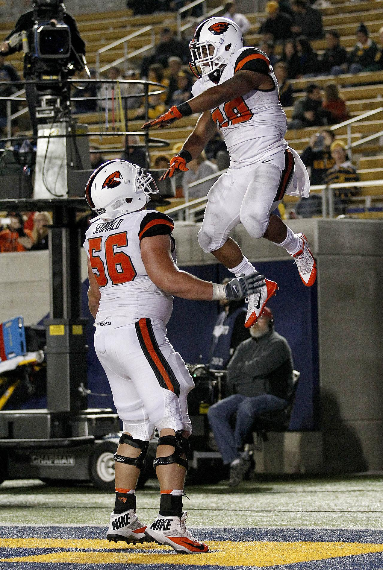 Oregon State running back Terron Ward (28) celebrates with teammate Isaac Seumalo (56) after scoring a touchdown against California during the second half of an NCAA college football game in Berkeley, Calif., Saturday, Oct. 19, 2013. Oregon State won 49-17