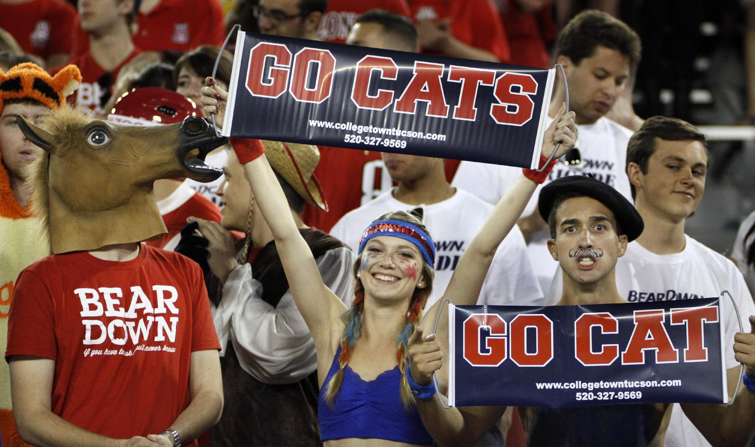 Arizona Wildcat fans show their spirit against Utah in the first half of an NCAA college football game, Saturday, Oct. 19, 2013 in Tucson, Ariz.  Arizona won 35 - 24