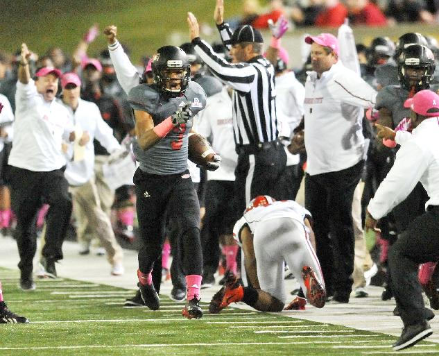 Arkansas State's Rocky Hayes (3) carries the ball after he intercepted a pass against Louisiana-Lafayette during the third quarter of an NCAA college football game Tuesday, Oct. 22, 2013, at Liberty Bank Stadium in Jonesboro, Ark