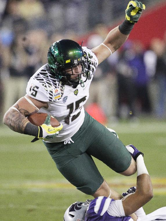 In this Jan. 3, 2013, file photo, Oregon tight end Colt Lyerla (15) is tackled by a Kansas State player during the first half of the Fiesta Bowl NCAA college football game, in Glendale, Ariz. Former Oregon tight end Lyerla, who left the second-ranked Ducks earlier this month following a one-game suspension for violating team rules, was in custody Thursday, Oct. 24, 2013, after his arrest on drug-related charges in Eugene. The sheriff's office said in a statement that Lyerla was observed by a drug investigation unit snorting a white powdery substance while sitting in a parked car Wednesday