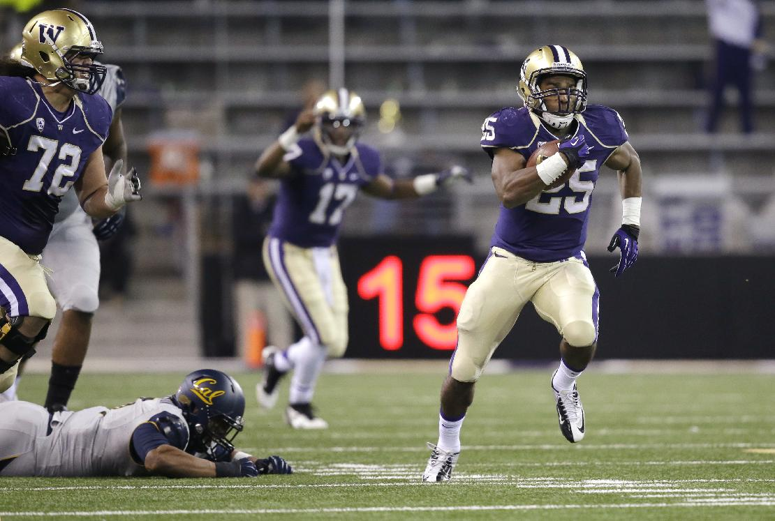 Washington's Bishop Sankey (25) takes off on a 59-yard touchdown run as quarterback Keith Price (17) cheers behind in the first half of an NCAA college football game against California Saturday, Oct. 26, 2013, in Seattle
