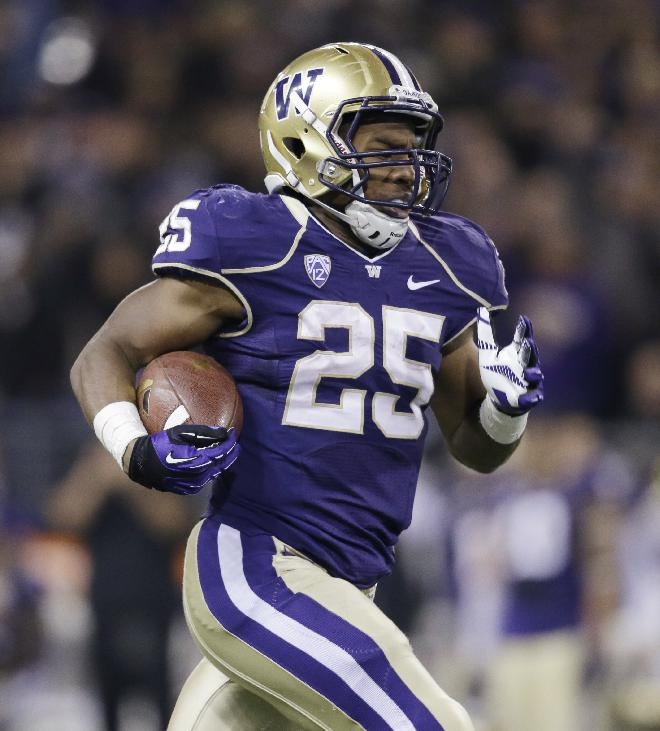 Washington's Bishop Sankey scores on a 59-yard touchdown run in the first half of an NCAA college football game against California Saturday, Oct. 26, 2013, in Seattle