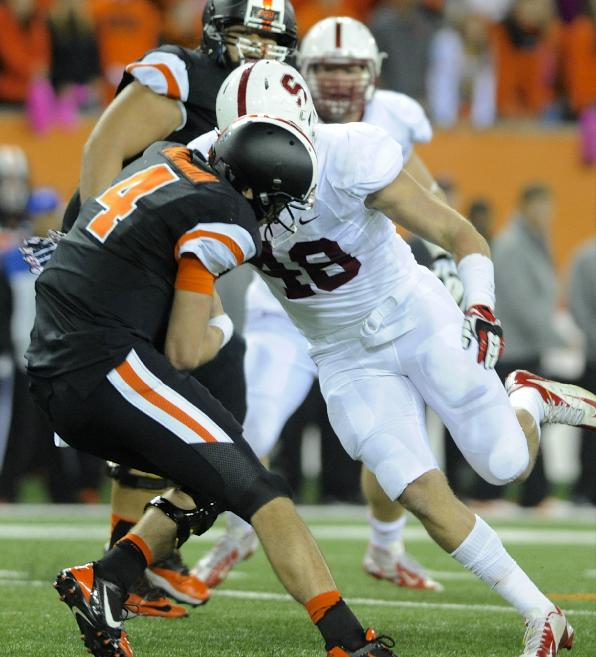Oregon State's quarterback Sean Mannion (4) is sacked by Stanford's Kevin Anderson (48) during the second half of an NCAA college football game in Corvallis, Ore., Saturday Oct. 26, 2013. Stanford beat Oregon State 20-12
