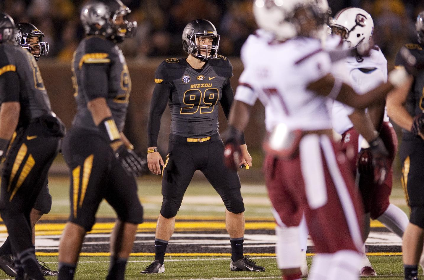 In this Oct. 26, 2013 photo, Missouri kicker Andrew Baggett (99), watches his extra point kick he made in the first overtime of Missouri's 27-24 loss to South Carolina an NCAA college football game in Columbia, Mo. College coaches and administrators concerned about tweets their athletes might send also should be wary of the ones their athletes receive. Social media experts point to vitriolic messages directed at football players Andrew Baggett of Missouri and Kenny Bell of Nebraska as examples of why schools should counsel athletes on how to cope with criticism crossing the line from heckling to hate