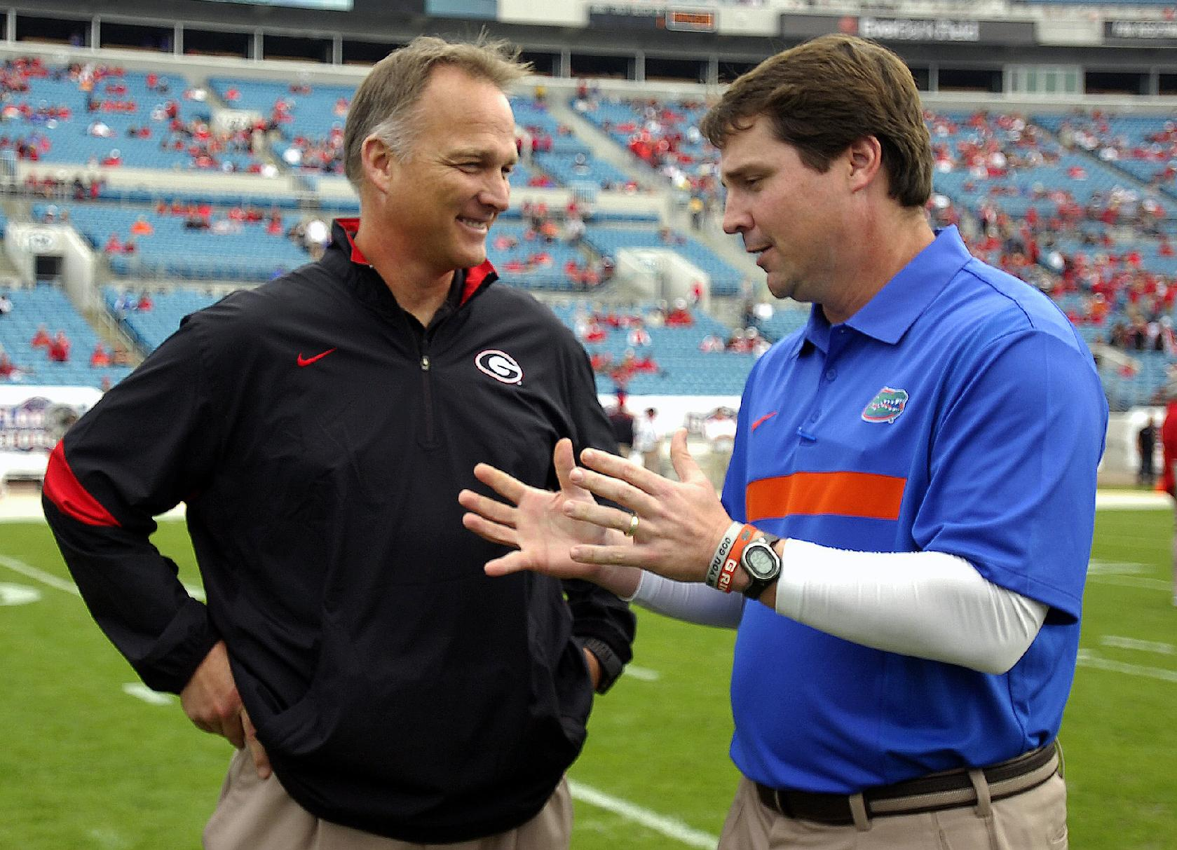 In this Oct. 29, 2011, file photo, Florida coach Will Muschamp, right, and Georgia coach Mark Richt talk before an NCAA college football game in Jacksonville, Fla. Georgia and Florida, teams that began the year with championship aspirations, have been ravaged by injuries and enter their annual Cocktail Party game at Jacksonville staring at the final gasp to make something of their disappointing seasons