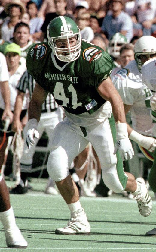 In this Dec. 26, 1989, file photo, Michigan State's Charles Bullough (41) chases a play during the Aloha Bowl NCAA college football game against Hawaii in Honolulu, Hawaii. With a family history at Michigan State that stretches back decades, linebacker Max Bullough can provide a unique perspective on this week's showdown with rival Michigan. Max's grandfather, father and two uncles, including Charles, played for the Spartans