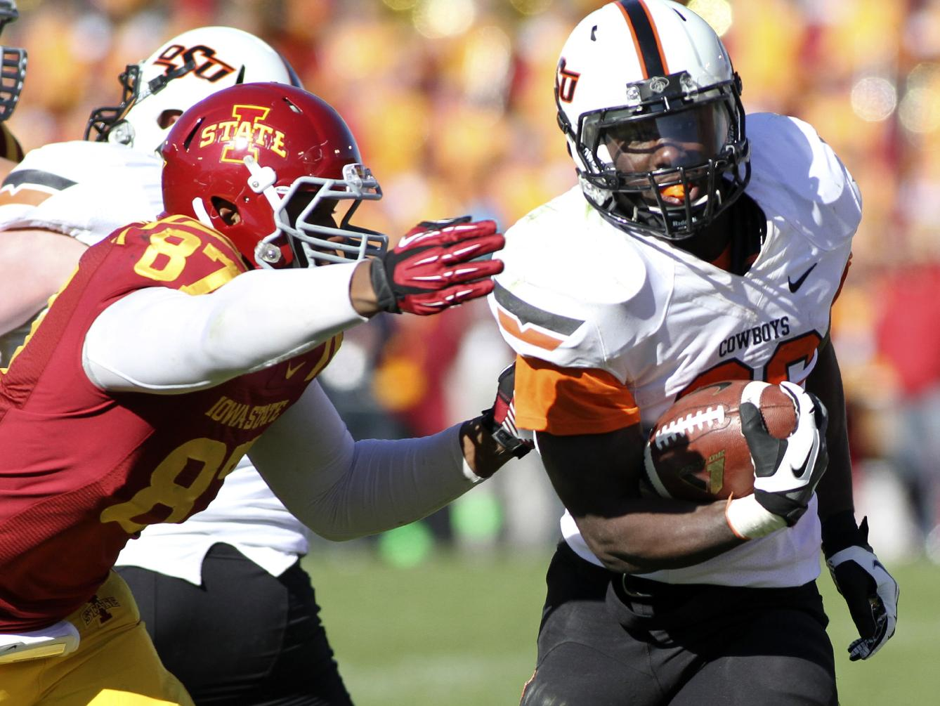 In this Oct. 26, 2013, file photo, Oklahoma State running back Desmond Roland (26) breaks away from Iowa State defensive lineman David Irving (87) during the second half of an NCAA college football game in Ames, Iowa. Roland provided Oklahoma State's running game with a much-needed boost in his first start last week, rushing for 219 yards in a win over Iowa State. The junior hopes to continue his production this week at Texas Tech. (AP Photo by Justin Hayworth, File)