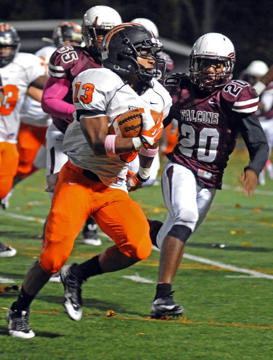 West Virginian Wesleyan's Michael Anderson, left, runs for yardage as Fairmont State's Jordan Armstrong closes in during a game in Fairmont, W.Va., Thursday, Oct. 31, 2013. West Virginia Wesleyan won in overtime 40- 37