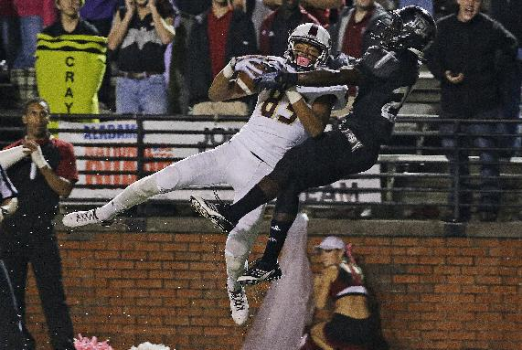 Troy cornerback Chris Davis, right, breaks up a pass intended for Louisiana-Monroe wide receiver Tony Cook during the second half of an NCAA college football game in Troy, Ala., Thursday, Oct. 31, 2013. Louisiana-Monroe won Troy 49-37