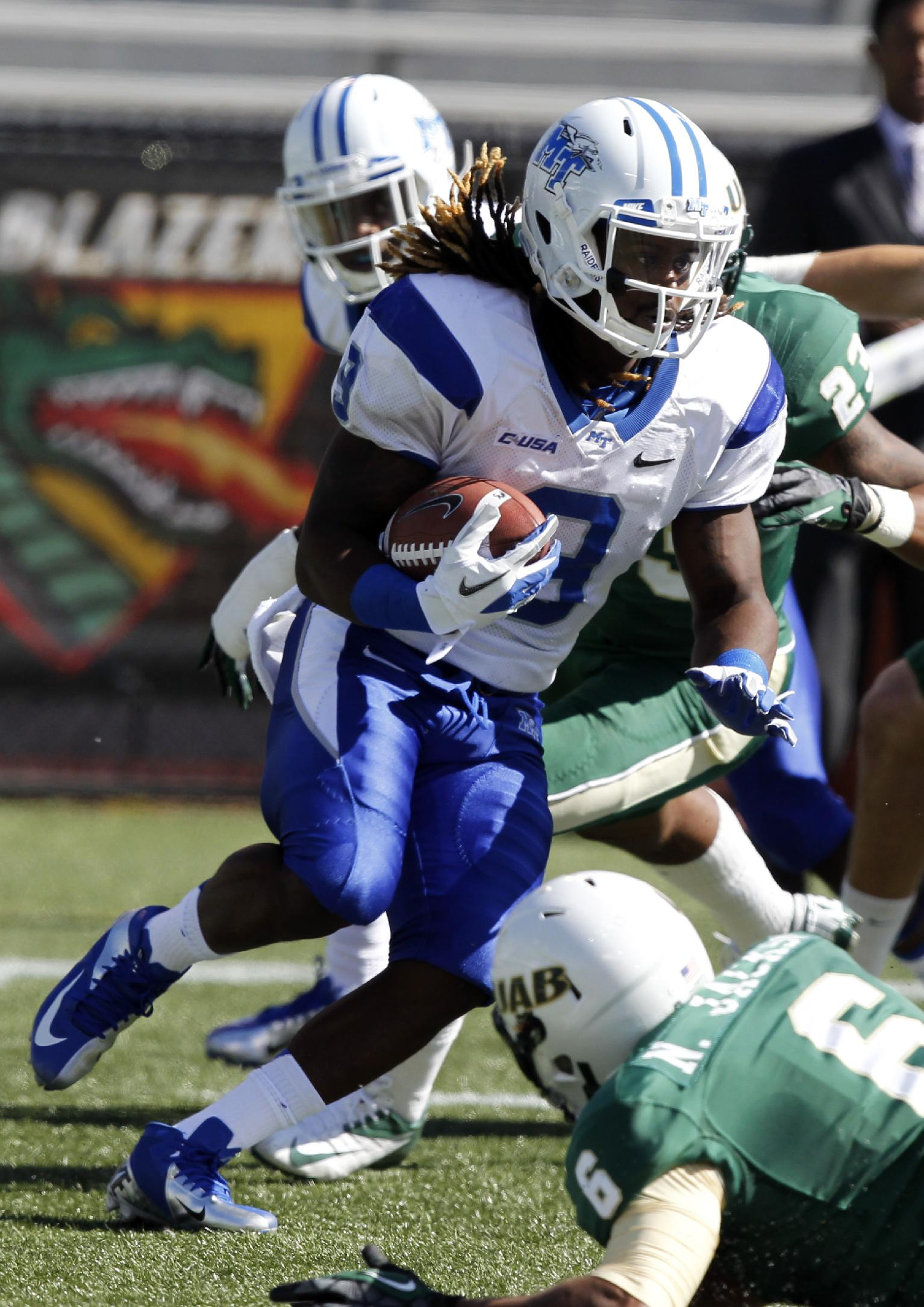 Middle Tennessee State wide receiver Tavarres Jefferson carries the ball during a kick return in the first half of an NCAA college football game against UAB on Saturday, Nov. 1, 2013, in Birmingham, Ala
