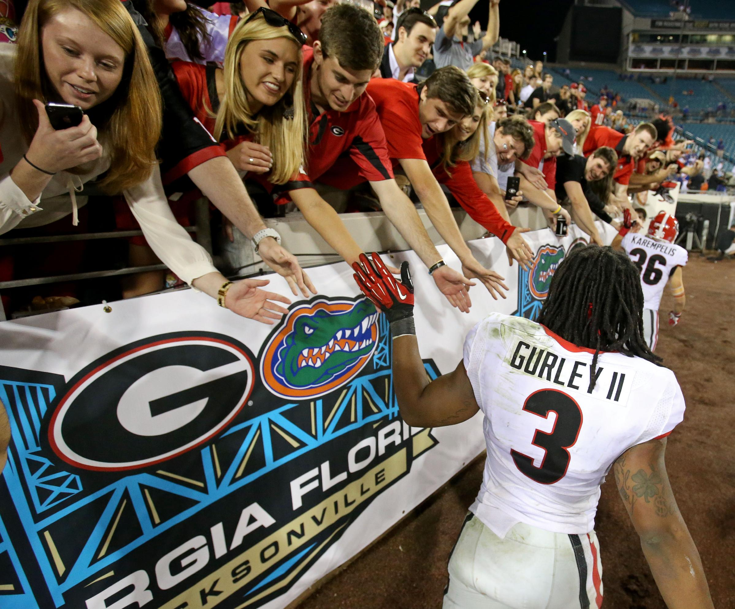 Georgia running back Todd Gurley (3) celebrates with fans following their 23-20 win over Florida after an NCAA football game, Saturday, Nov. 2, 2013 at Alltel Stadium in Jacksonville, Fla