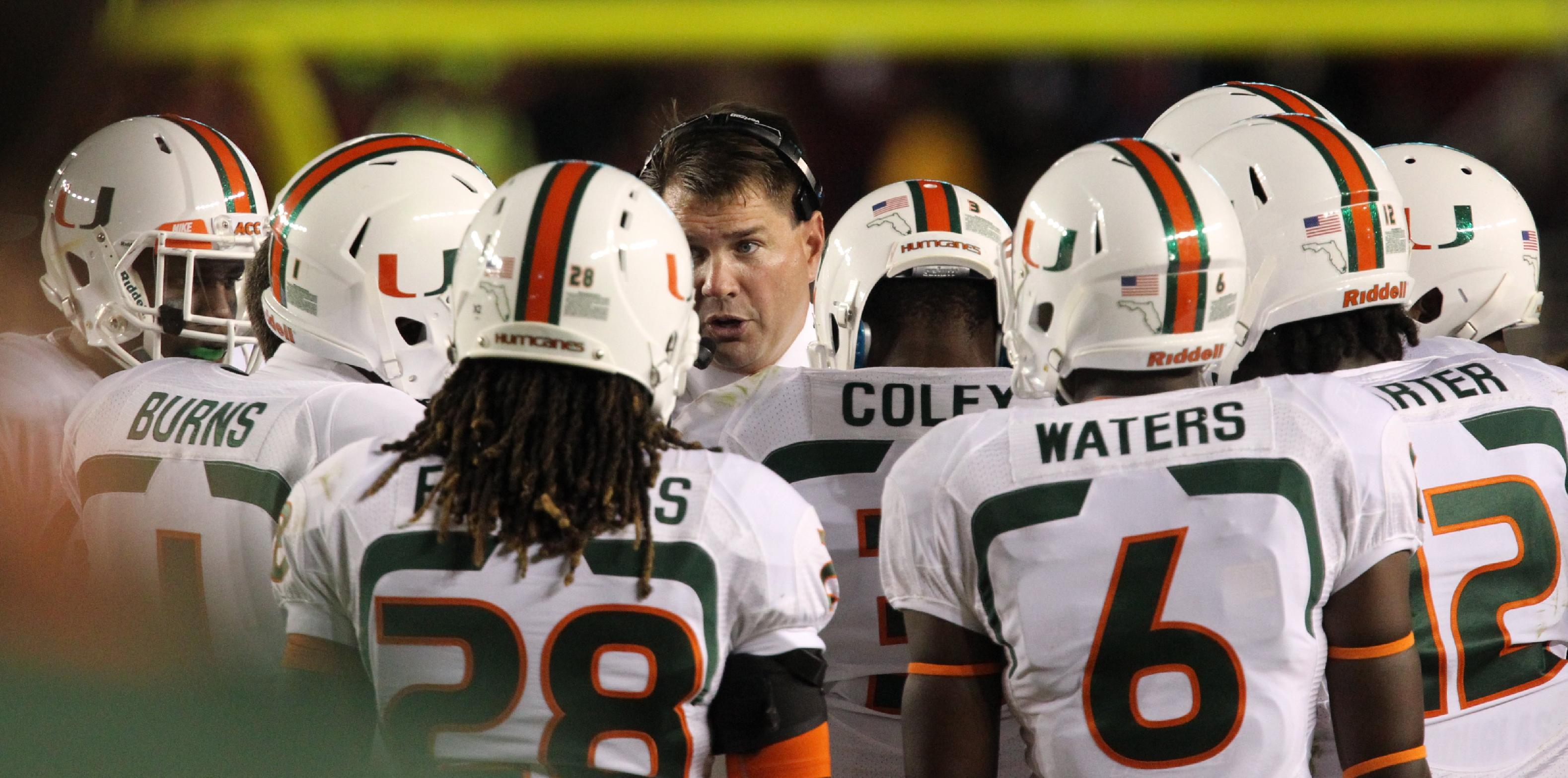 Miami coach Al Golden gathers his squad between plays in the second quarter against Florida State during an NCAA college football game Saturday, Nov. 2, 2013, in Tallahassee, Fla
