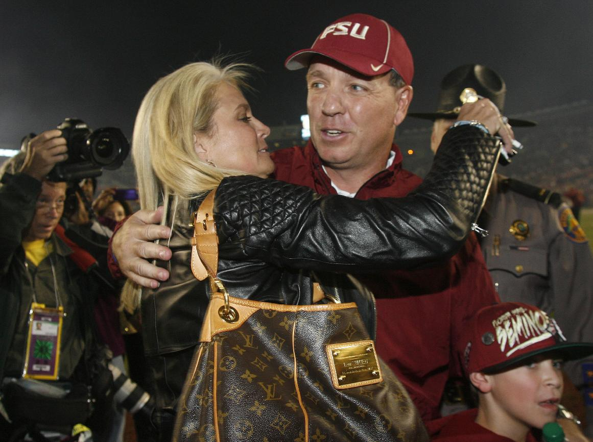 Florida State coach Jimbo Fisher hugs his wife, Candi, after the team defeated Miami 41-14 during an NCAA college football game Saturday, Nov. 2, 2013, in Tallahassee, Fla