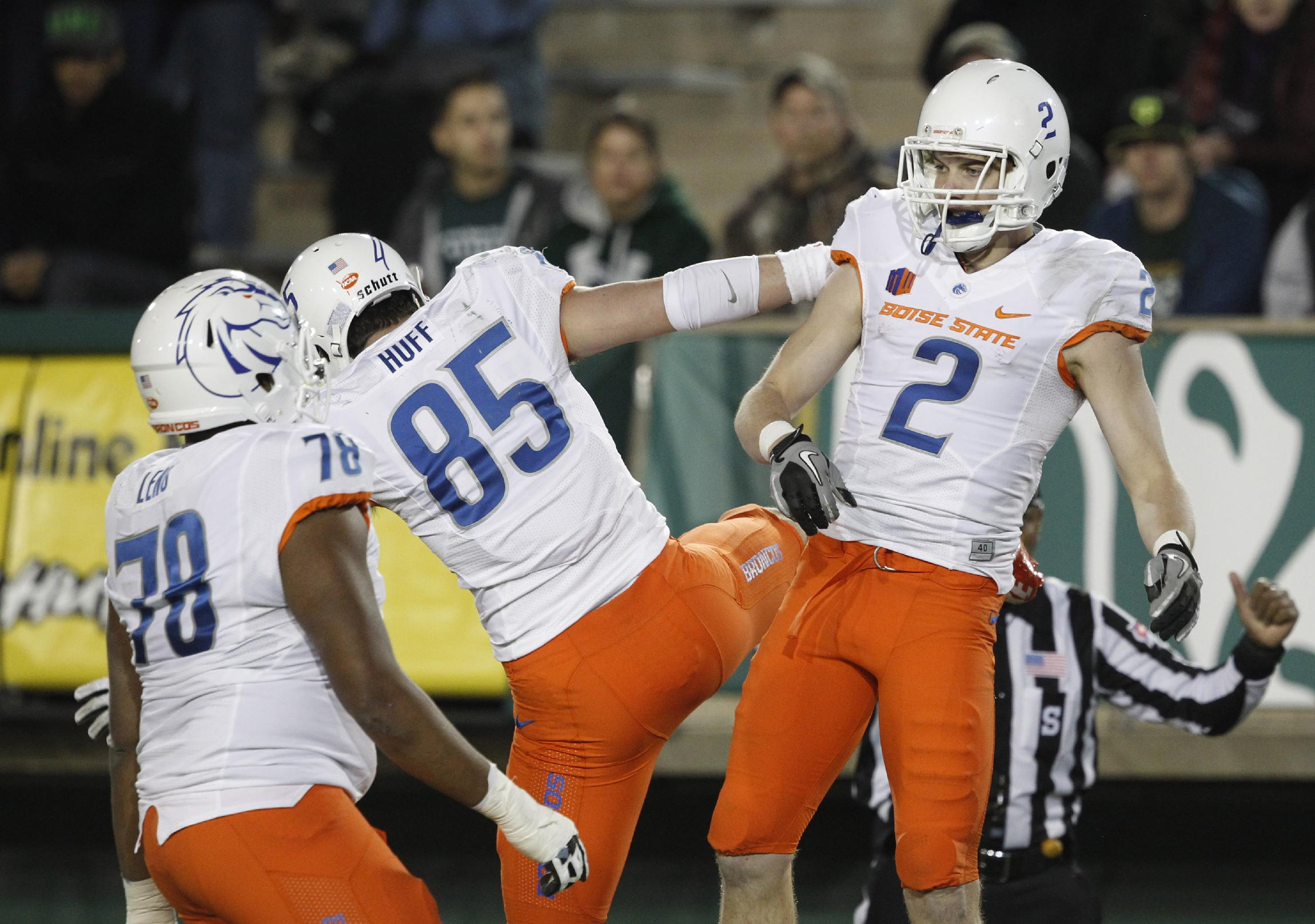 Boise State wide receiver Matt Miller, right, celebrates his touchdown reception with tight end Holden Huff (85) as offensive lineman Charles Leno Jr., front, arrives, against Colorado State in the third quarter of Boise State's 42-30 victory in an NCAA college football game in Fort Collins, Colo., on Saturday, Nov. 2, 2013