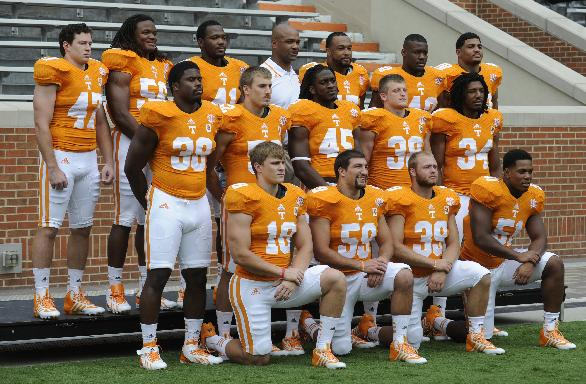 In this Aug. 15, 2013 photo, Tennessee linebackers pose with linebackers coach Tommy Thigpen, back row, center,  during media day at Neyland Stadium in Knoxville, Tenn. Thigpen and secondary coach Willie Martinez both worked at Auburn last year while the Tigers struggled through a 3-9 season. They say they aren't surprised by Auburn's transformation into an SEC contender this year