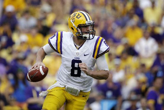 In this Oct. 12, 2013 file photo, LSU quarterback Zach Mettenberger (8) scrambles in the second half of an NCAA college football game against Florida in Baton Rouge, La. No. 10 LSU's Mettenberger and No. 1 Alabama's AJ McCarron typically only run as a last resort, unlike the many quarterbacks running spread offenses. But the two dropback passers are every bit as formidable heading into Saturday night's showdown