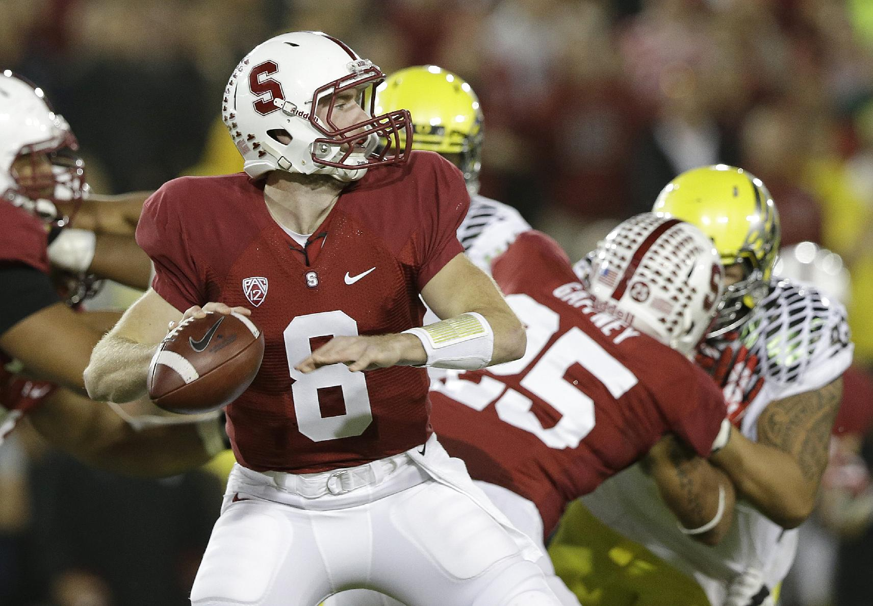 Stanford quarterback Kevin Hogan (8) passes against Oregon during the first quarter of an NCAA college football game in Stanford, Calif., Thursday, Nov. 7, 2013