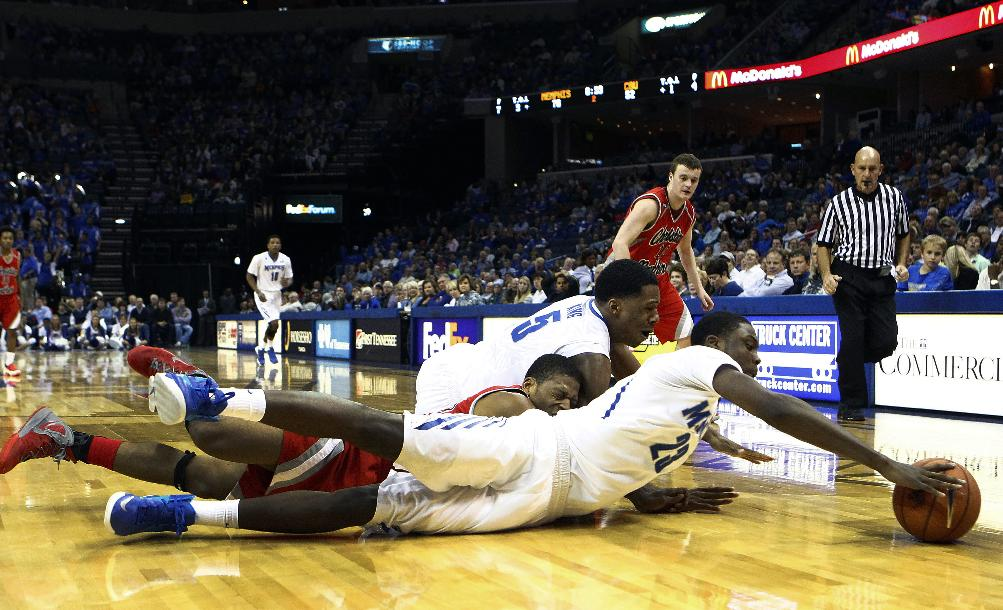 Memphis' Kuran Iverson, front, and teammate Nick King, back, battle Christian Brothers University's Drew Hildreth for a loose ball during the second half action of an NCAA college basketball game Friday, Nov. 8, 2013, in Memphis, Tenn