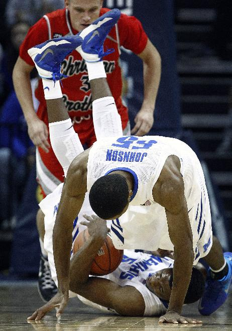 Memphis' Nick King, bottom, and teammate Geron Johnson, middle, battle for a loose ball as Christian Brothers University's J.T. Moody stands by during the first half of an NCAA college basketball game Friday, Nov. 8, 2013, in Memphis, Tenn