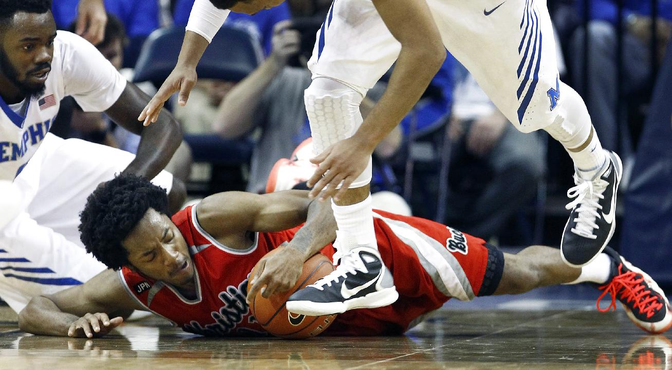 Christian Brothers University's Harry Green, center, grabs a loose ball during the first half of an NCAA college basketball game against Memphis, Friday, Nov. 8, 2013, in Memphis, Tenn