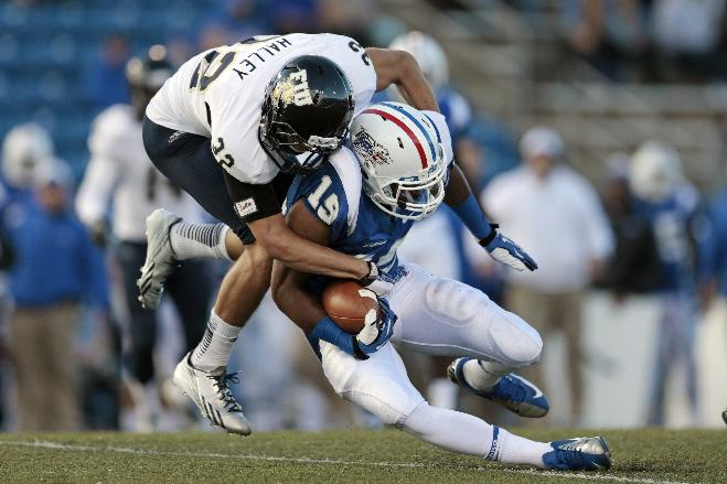 Middle Tennessee wide receiver Marcus Henry (19) is brought down by Florida International safety Justin Halley (32) in the first half of an NCAA college football game on Saturday, Nov. 9, 2013, in Murfreesboro, Tenn