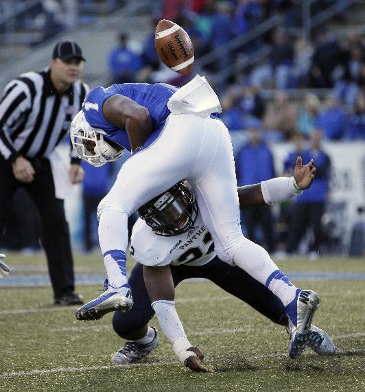 Florida International linebacker Markeith Russell (22) hits Middle Tennessee running back Shane Tucker (1) in the first half of an NCAA college football game on Saturday, Nov. 9, 2013, in Murfreesboro, Tenn