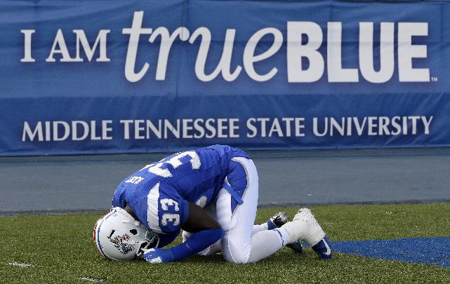 Middle Tennessee linebacker Roderic Blunt prays before the start of an NCAA college football game against Florida International on Saturday, Nov. 9, 2013, in Murfreesboro, Tenn