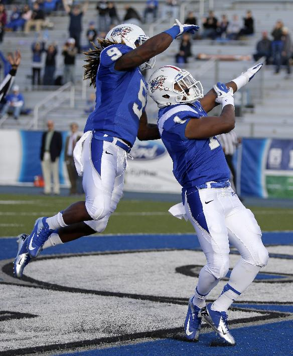 Middle Tennessee running back Shane Tucker, right, celebrates with wide receiver Kyle Griswould (9) after Tucker scored a touchdown against Florida International on a 48-yard run in the first quarter of an NCAA college football game on Saturday, Nov. 9, 2013, in Murfreesboro, Tenn