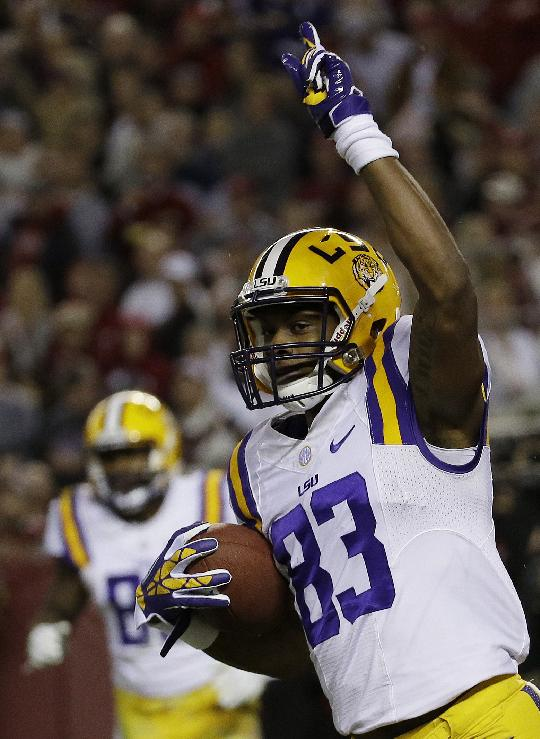 LSU wide receiver Travin Dural (83) celebrates his touchdown against Alabama during the first half of an NCAA college football game, Saturday, Nov. 9, 2013, in Tuscaloosa, Ala