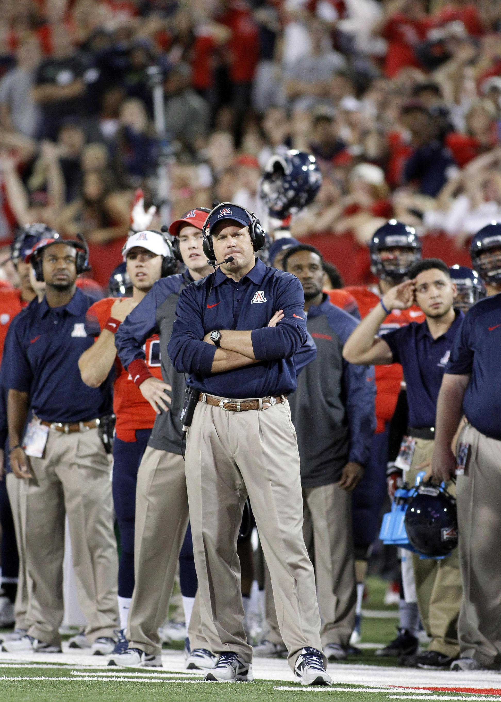 Arizona's head coach Rich Rodriguez, center, is upset with the play of his team again UCLA in the second half of an NCAA college football game on Saturday, Nov. 9, 2013 in Tucson, Ariz