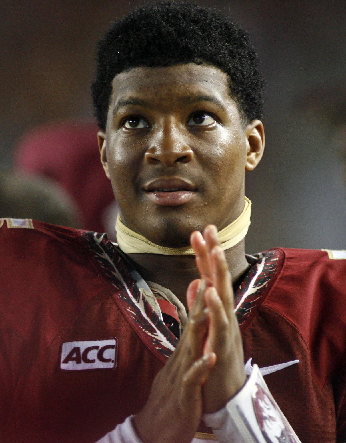 In this Sept. 21, 2013, file photo, Florida State quarterback Jameis Winston watches from the sidelines during the second half of an NCAA college football game against Bethune-Cookman in Tallahassee, Fla. Winston is under investigation in an alleged sexual assault reported nearly a nearly a year ago, the university and Winston's attorney confirmed on Wednesday, Nov. 13, 2013