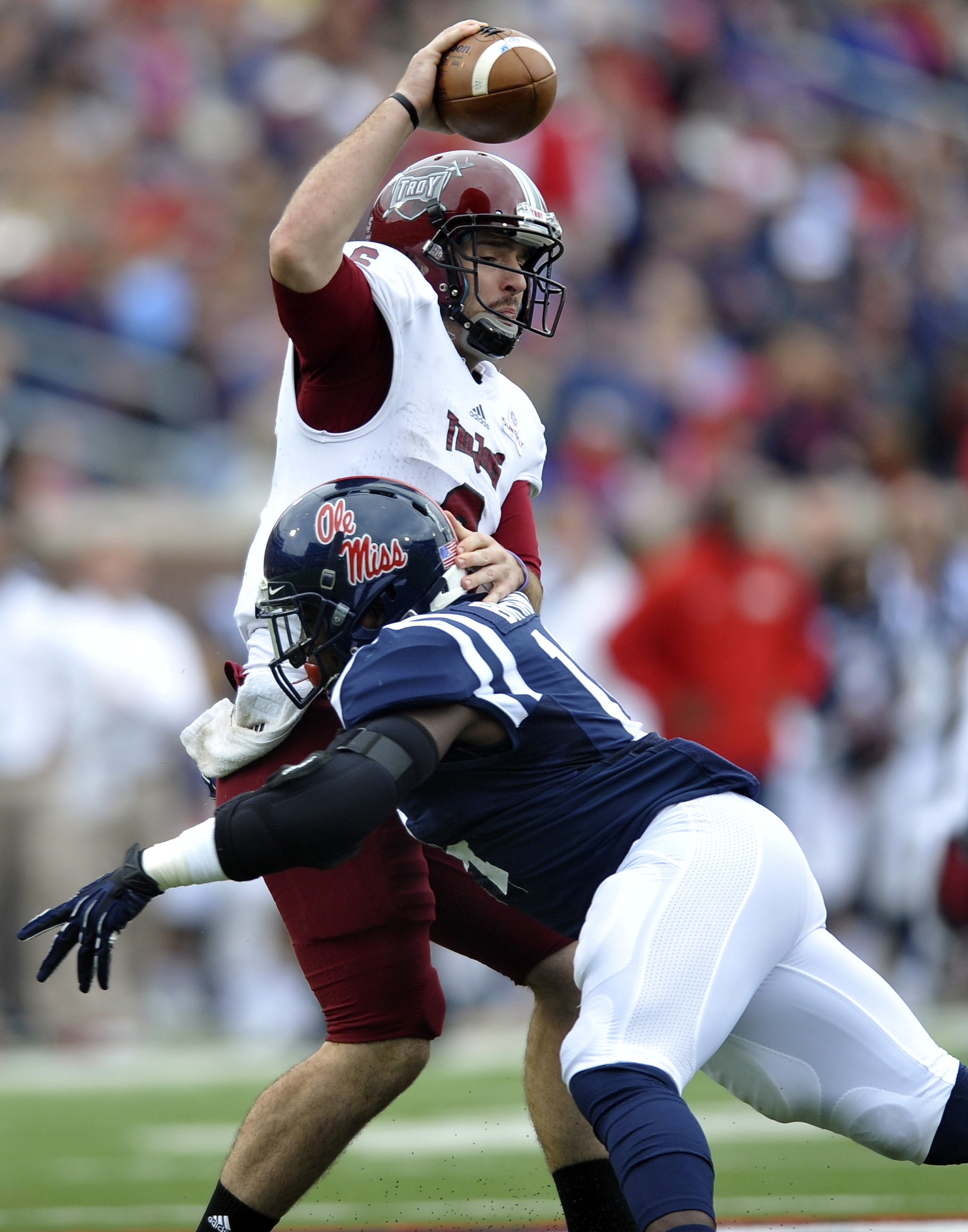 Mississippi linebacker Serderius Bryant (14) sacks Troy quarterback Corey Robinson (6) during an NCAA college football game in Oxford, Miss., Saturday, Nov. 16, 2013. Troy recovered the ball