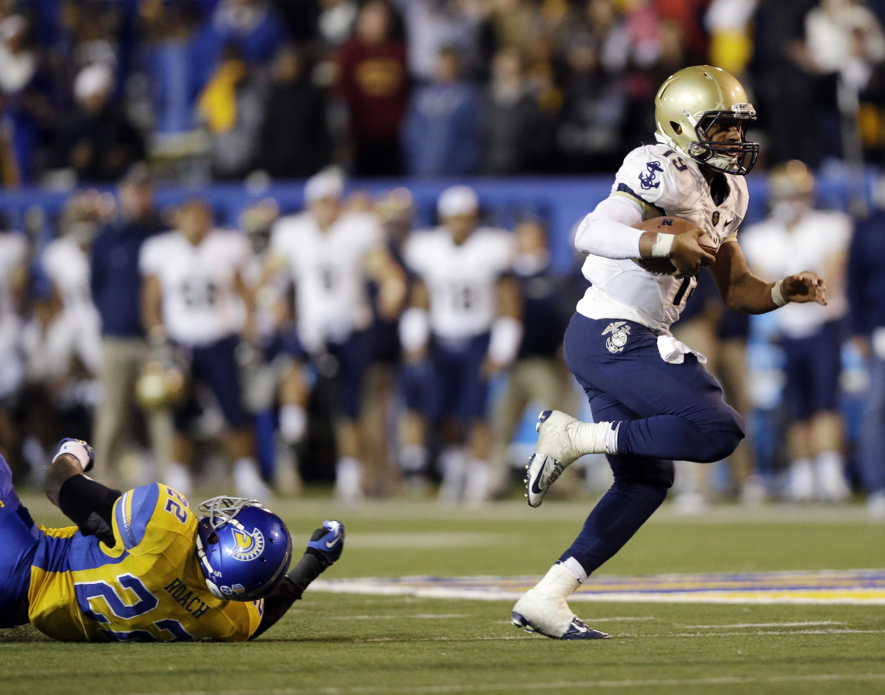 Navy quarterback Keenan Reynolds, right, runs past San Jose State linebacker Hector Roach (22) for a touchdown during the first overtime of an NCAA college football game on Friday, Nov. 22, 2013, in San Jose, Calif.  Navy won 58-52 in triple overtime