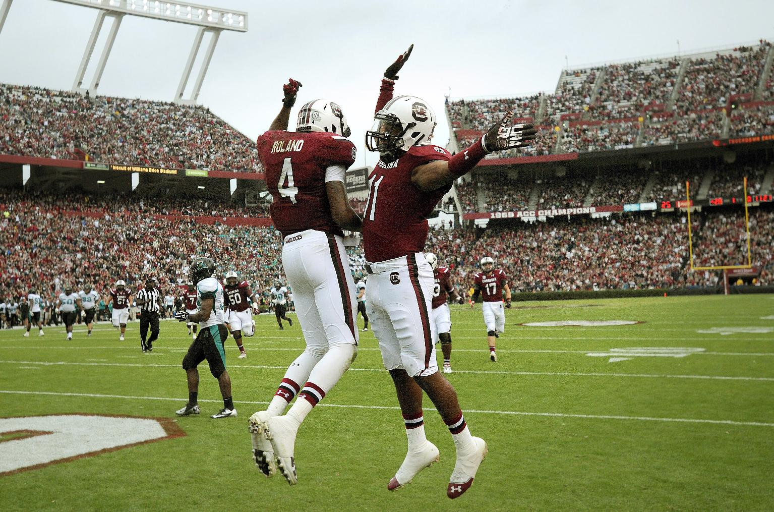 South Carolina wide receivers Pharoh Cooper (11) and Shaq Roland (4) celebrate Cooper's touchdown during the first half of an NCAA college football game against Coastal Carolina, Saturday, Nov. 23, 2013 in Columbia, S.C